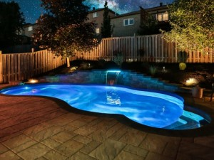 Night view of in-ground pool in Barrie